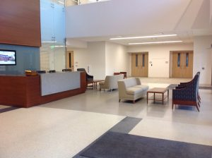 Lobby with desk and chairs