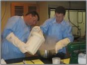 Scientists conducting experiment