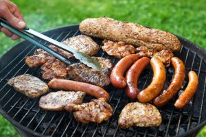 tailgater grilling meat