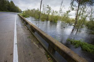 Raeford, North Carolina, United States/August 17, 2018: Flood waters backing up on a bridge just south of Raeford North Carolina after Hurricane Florence