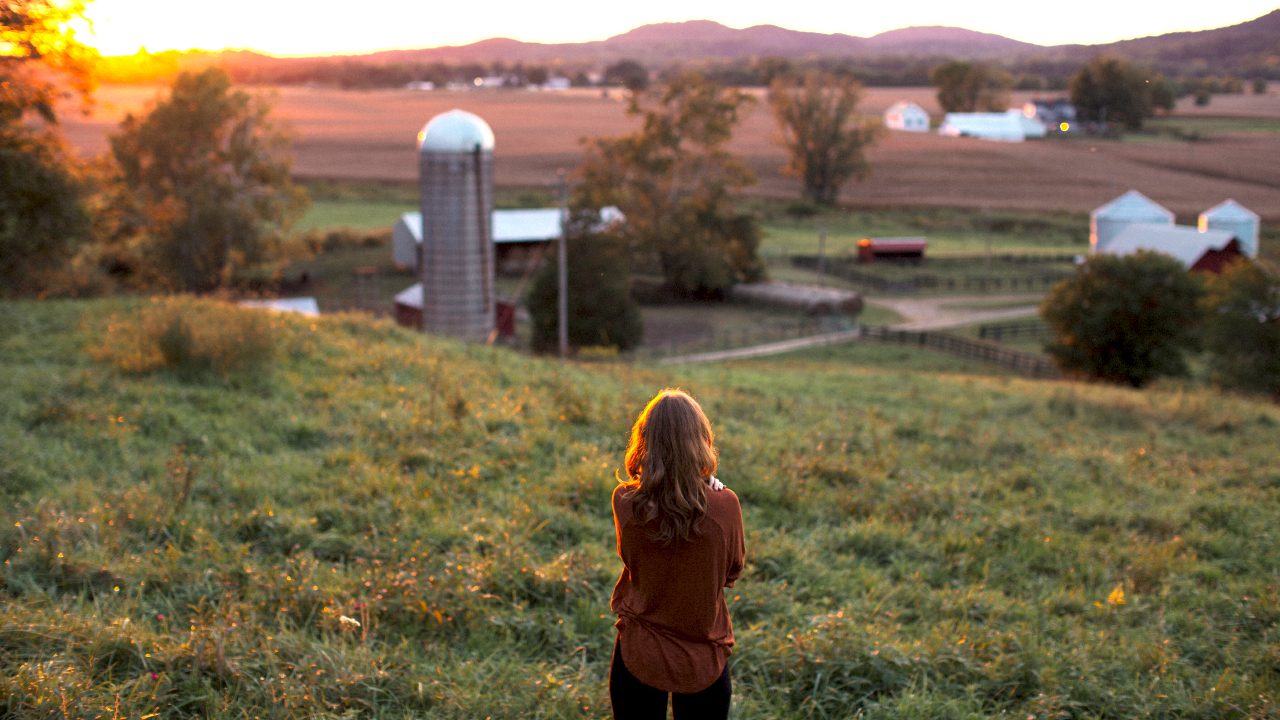 College girl on production family farm in the afternoon sunlight