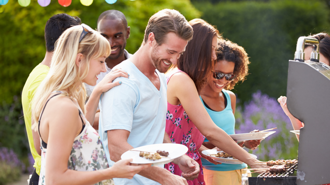 Group of neighbors having a southern backyard barbecue grill